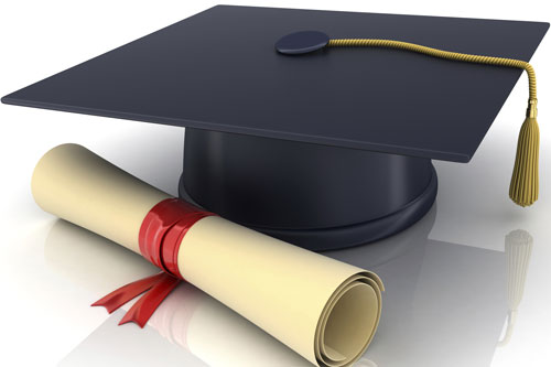 Graduate cap and rolled diploma on a white background